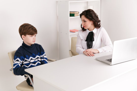 Teen boy talking to his therapist. Social worker and patient