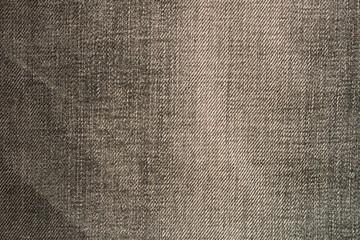 Texture of black jeans. Natural denim background. Close up.