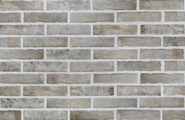 Dirty grey brick wall texture background.