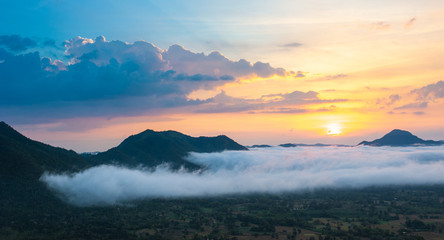 Beautiful dramatic sunset in the mountains. Landscape lot of fog Phu Thok Mountain at Chiang Khan ,Loei Province in Thailand.