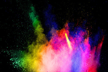 Multicolored powder explosion on white background.Abstract colorful dust particles textured background.