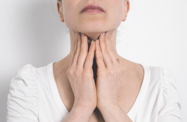 The woman has a thyroid disorder. Sore throat. Inflamed glands.