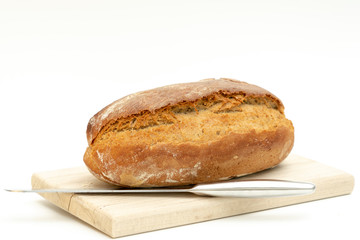 freshly baked bread lies on a wooden board
