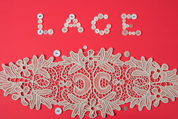 Macrame lace art work on coral background