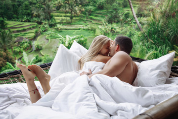 Honeymoon at Bali, Ubud. Successful couple relaxing at villa, beautiful view