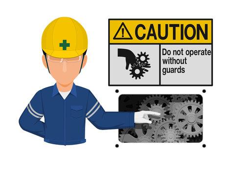 Industrial worker is presenting mechanical hazard sign