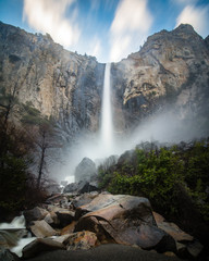 Bridalveil Falls located in Yosemite National Park during springtime. Mist and spray coming off the waterfall.
