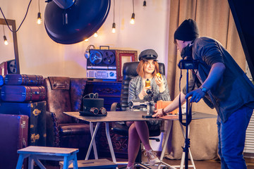 Vlog. Studio for shooting video. The operator adjusts the video camera. Video review. A man smashes video cameras for shooting a video blog.