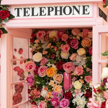 A telephone box decorated with beautiful roses