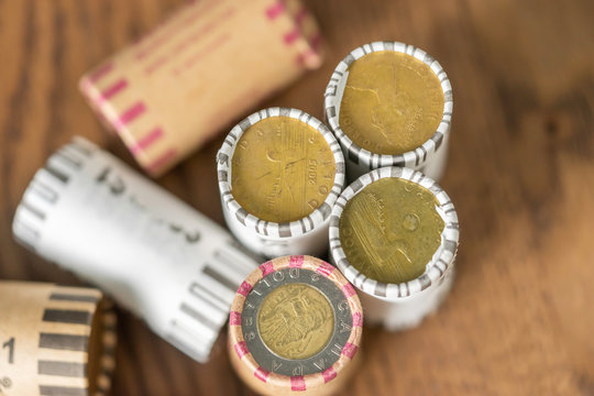 Wrapped stacks of canadian dollar coins to allow easy counting