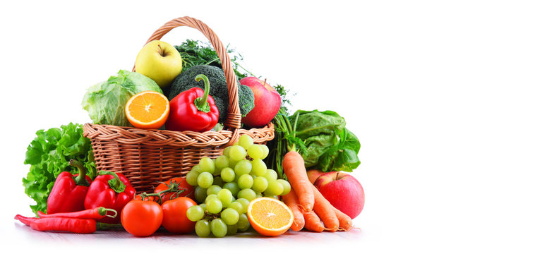 Fresh organic fruits and vegetables in wicker basket