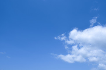 Blue sky background and white clouds with copy space, good for message and background.