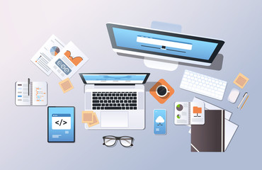 cloud data center computer connection hosting server database synchronize concept top angle view desktop laptop smartphone tablet screen office stuff horizontal