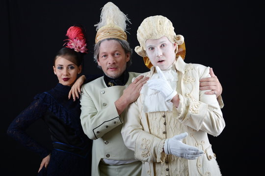 actors in wigs and old costumes