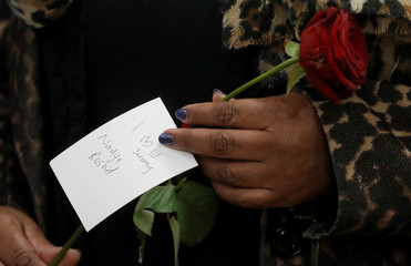 Labour Party MP Diane Abbott holds a red rose handed out at Finsbury Park Mosque during a visit by Britain's Labout Party leader, Jeremy Corbyn, on Visit My Mosque day, in London