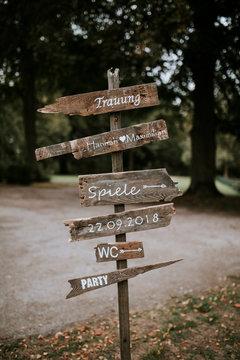 wooden signpost decoration on a vintage boho wedding