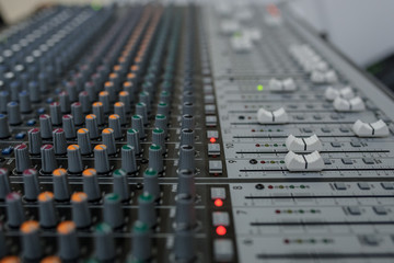 Close up photo of a mixing console of a DJ