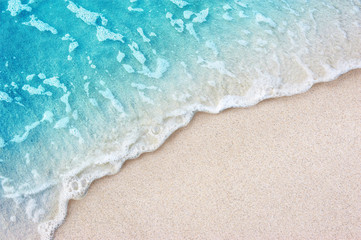 Wall Mural - Soft blue ocean wave on clean sandy beach
