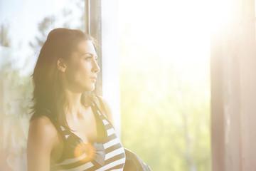 girl by the window in backlight