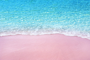 Wall Mural - Soft blue ocean wave on pink sandy beach