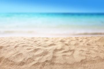 Wall Mural - beautiful sandy beach with blur ocean background summer concept
