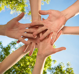 volunteers people hands together outdoors