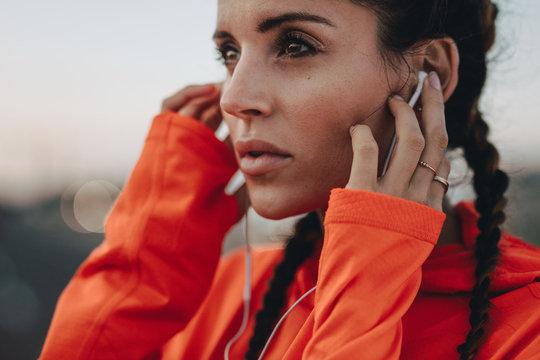 Female athlete with earphones