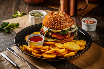 American burger with fried potatoes