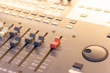 audio mixing console fader. music production, post production, recording concept