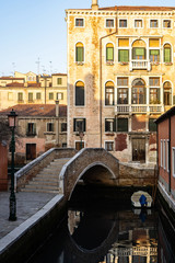 Classical picture of the venetian canals with in beautiful evening light.