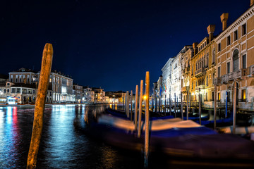 Night shot of Grand Canal and gondolas in Venice, Italy.