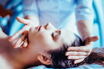 Woman having spa body massage treatment in the spa salon. Toned image.