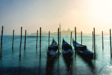 San Giorgio Maggiore church and gondolas in Venice during a misty/foggy spring day.