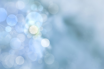 Sunny abstract bright blue bokeh spring or summer background texture with leaves. Space for your design.