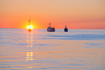 At sunset, ships in the White sea pay tribute to the dead sailors.