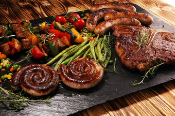 Assorted delicious grilled meat with vegetable on a barbecue with steak