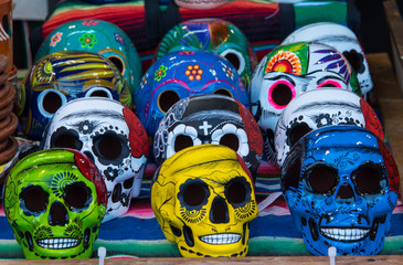 brightly colored ceramic skulls