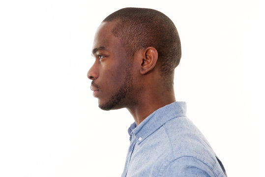 Close up profile of handsome young black man against isolated white background