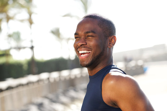 Close up happy young black man outdoors