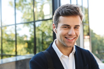 Close up of a smiling young business man