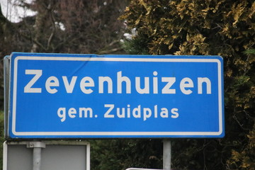 Blue and white sign  to mark the start of the urban area in Zevenhuizen in the Netherlands