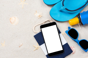 White screen mobile device on sandy beach