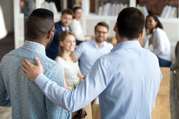 Boss introducing black new worker to workmates