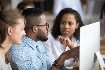 Black african male explains women interns corporate program