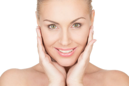 Simply perfect. Horizontal portrait of a beautiful mature woman cupping her face in her hands and smiling confidently
