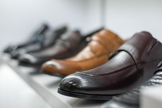 Blurred store shelf with a elegant male shoes background.