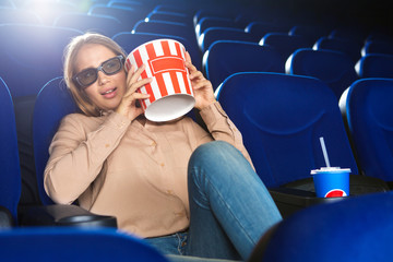 Beautiful young woman at the cinema