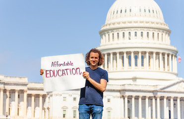 Protester holding sign for affordable education in hands