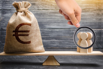 Magnifying glass is looking at a money bag with a euro sign and people on the scales. evaluation of the cost of the work of specialists and workers. business cooperation, crowdfunding and startup.