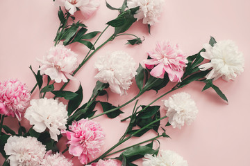 Stylish pink and white peonies bouquet on pink paper flat lay. Creative floral image. Happy mother's day. International womens day. Greeting card mockup.